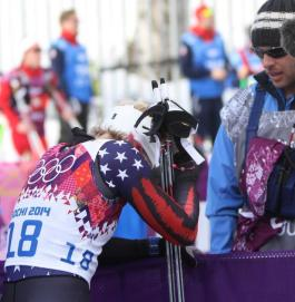 Kikkan Randall with her husband after being eliminated early in Tuesday's freestyle sprint at the 2014 Olympics.